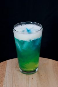 Banana Liqueur & Pineapple Mixed Drink with Blue Curaçao